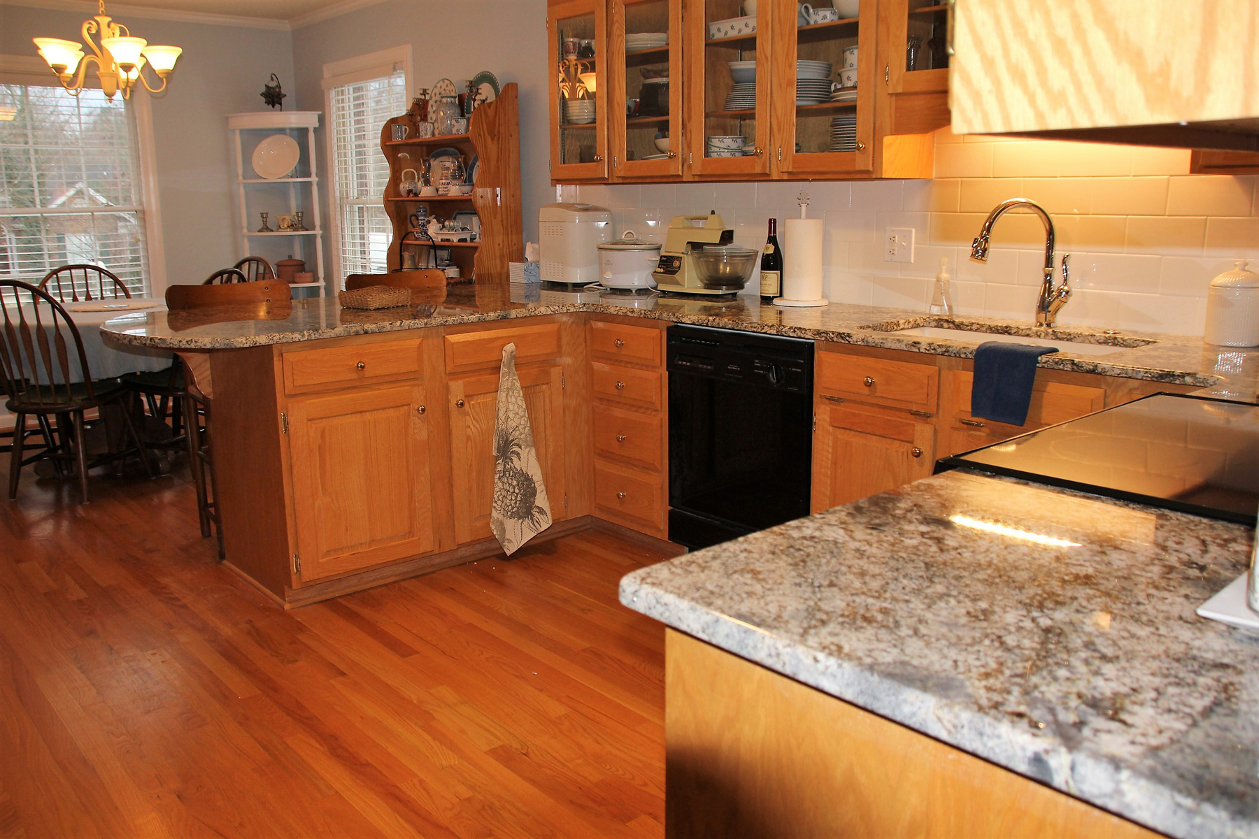 ... The Existing Golden Oak Cabinets, Since They Offered Clean Lines And  Sturdy Construction. Gorgeous New Blue Flower Granite Countertops Really  Make Those ...